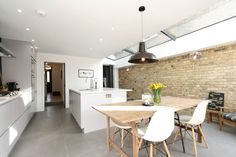 Adys Road, Industrial kitchen, exposed brick wall with large ceiling glass and lovely quartz marbled worktop