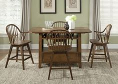 Bean Oak Pub Island Table  $599.99 Sku:111597 Dimensions:36Wx60Dx36H The Bean Collection comes to life with the rustic flowing details and warm inviting finishes to create the ultimate in relaxing home decor. Made with the Rubberwood Solids & Oak Veneers covered in Rustic Oak Finish, the pieces are perfectly complemented by the Antique Brass Knob Hardware. Please visit our website for warranty and benefits.