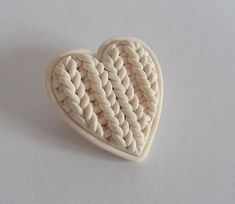 Polymer clay 'knitted' heart brooch