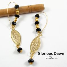 www.facebook.com/sharajewelry    A ravishing pair of dangler earrings suit every occasion and can go with variety of outfits. Colour combination of these  earrings is timeless. Very classy and must have earrings for all.