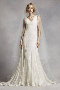 Soft and elegant, this etheral wedding gown crafted from luxurious lace and textured net will be one to remember!    Stunning beaded lace and textured net creates an eye-catching look.  Diagonal seaming defines and flatters waist while ensuring a perfect fit.  Fully lined. Zipper back. Imported polyester. Dry clean.  Extra Length and Extra Length Woman: Style 4XLVW351283.  To preserve your wedding dreams, try our Wedding Gown Preservation Kit.