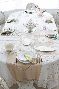 tablecloth made from a combination of vintage cloths.. fabulous