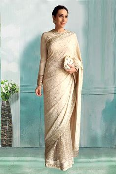 Bollywood Special - Bollywood Inspired - Karisma Kapoor In Off White Saree - 80751 - Products Details : Style : Bollywood Style Party Wear Saree / Wedding Wear Saree Saree Size : Free Size Off White Saree, White Sari, White Saree Wedding, Indian Wedding Outfits, Indian Outfits, Reception Sarees, Trendy Sarees, Elegant Saree, Saree Look