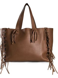 Shop Valentino Garavani 'C-Rockee' fringed tote in CHUCKiES New York from the world's best independent boutiques at farfetch.com. Over 1500 brands from 300 boutiques in one website.