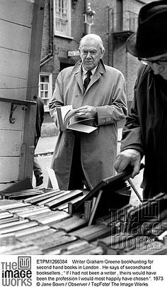 Graham Greene hunting for second hand books in London. He says of secondhand booksellers : ' If I had not been a writer, theirs would have been the profession I would most happily have chosen .'1973 © Jane Bown / Observer / TopFoto/ The Image Works