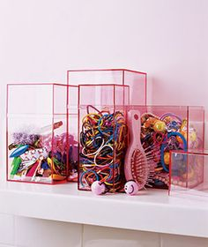 Box It  In the bathroom, hair ribbons, ponytail holders, and barrettes are a pretty, well-ordered still life instead of the snarled, clumpy mess they become when they're shoved into a drawer.   40 cents to $3.20 each, containerstore.com.