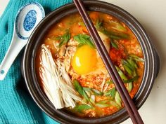 This Korean spicy tofu stew (Sundubu) is the perfect meal to have on a cold, dark, winter day. It's hearty, spicy, and satisfying! Scoop and serve on rice!