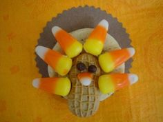 Nutter butters, Reese's cups, candy corn and mini choc chips, use canned frosting as glue