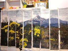 I was part of a group creating slices of quilts from a photo.  My slice is second from the right.