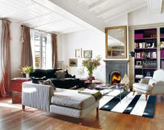 Laid back elegance~ striped rug, chaise, carved chair. Love it all.
