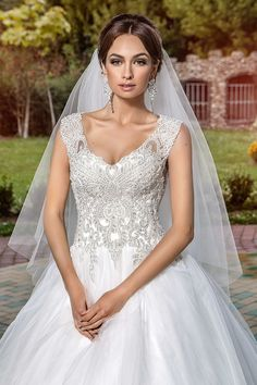 The Pretty And Delectable Frontal Sweetness Of A Simply Gorgeous Wedding Gown And Lovely Veil.