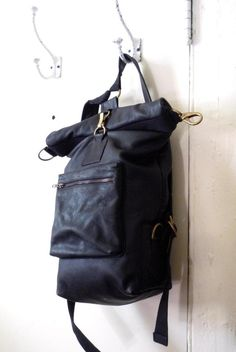 TM1985 top roll leather bags.