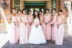 Pale pink bridesmaid dresses.