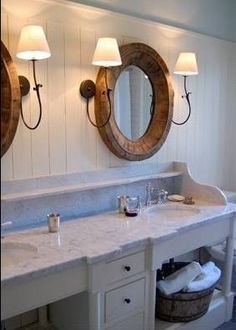 bathroom wall treatment tongue and groove wall, double wood mirrors, mirror flanked by sconces, marble vanity top, double vanity