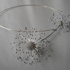 Necklace | Jolanta Bromke.  Sterling silver and synthetic threads