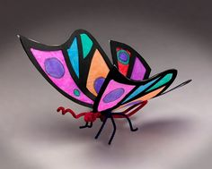 Celebrate wildlife and warm tropical weather! Cut and color a flock of these bright winged creatures!