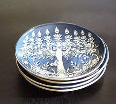 I don't celebrate Hanukkah, but these plates are so pretty.  Tree of Life Menorah Salad Plate, Set of 4 | Pottery Barn