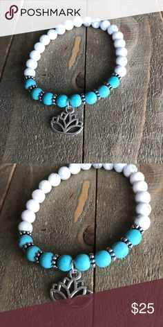 Handmade Turquoise & Howlite Lotus Bracelet Handmade Natural Turquoise Stone and Natural white Howlite Stone with silver lotus charm and silver spacer beads. Fits 6-7 inch wrists and is made of elastic stretch material. handmade Jewelry Bracelets