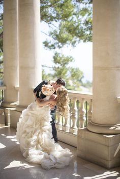 Gorgeous shot of the groom leaning the bride and kissing her, Photography by Samuel Lippke Studios