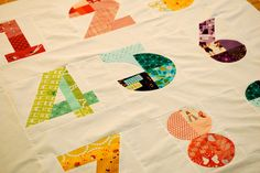 Colorfully pieced numbers quilt. so clever!