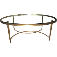 Bronze and Glass Oval Coffee Table | From a unique collection of antique and modern coffee and cocktail tables at https://www.1stdibs.com/furniture/tables/coffee-tables-cocktail-tables/