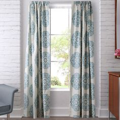 Effortlessly enhance your home decor with the Stone Cottage Bristol Lined Window Panel Set. These panels feature an aqua scroll medallion pattern over an ivory ground for a clean, simple look that you