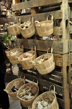 Here's an awesome idea: Hang baskets on a pallet! And it's so easy! Find a great pallet, lean it upright, hammer in some strong nails, and hang your baskets! You could have fruit in there, bread, f...