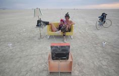 """Jody Friedman and Jeff Montgomery relax in front of the """"Playa TV"""" on Aug. 30."""