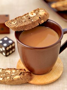 If you love biscotti with your coffee, here's a cookie recipe that lets you indulge. Flavored ground coffee colors these twice baked cookies that are filled with hazelnuts and cinnamon chips/dcc