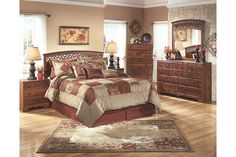 Raw beauty with a note of refinement. The Timberline queen panel bed brings a sense of earthiness and warmth into your space. The richness and character of a replicated timber cherry grain is enhanced with antiqued faux metal scrolling for an organic element. Mattress available, sold separately.