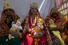 DOLLED UP: Indian women held baby dolls as they waited to take part in a procession for Ram Navami, which marks the birthday of Hindu god Lord Rama, in New Delhi on Friday. (Tengku Bahartengku/AFP/Getty Images)
