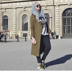 gray scarf/hijab + gray Adidas sweatshirt + skinny jeans + olive green long coat + olive green Adidas Campus sneakers