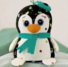 Idea for cute Penguin pincushion.  Pattern and Instructions on how to make.