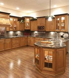 Maple spice with Mocha Glaze Cabinets with dk gray granite.
