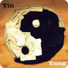 Yin-Yang; A taijitu interpreted with a laundry pile of socks. Interestingly, the yin and yang are labels were placed adjacent to the other design element, but their label typography is the correct color.