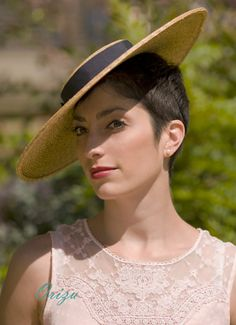 A beautiful contemporary boater hat, made in natural straw braid. Perfectly proportioned. Uncluttered sophistication. Perfect for any summer