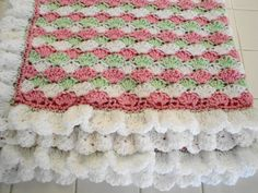 Crocheted shell stitch baby blanket in pink green and white with frilly white shell border by AuntieJenniesAttic on Etsy