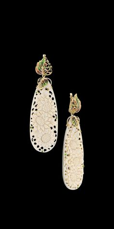 Earrings:  14К yellow gold, ivory 91,56 ct, diamonds, cognac diamonds, green diamonds, colored sapphires, tsavority, demantoids.