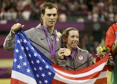 Mike Bryan and Lisa Raymond of the U.S. pose with their bronze medals at the ceremony for tennis mixed doubles