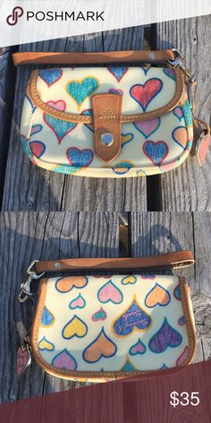 🆕List! Dooney & Bourke Hearts Wristlet! GUC! Some water spots on handle. Measures approximately 6x4 inches. More coming soon. Dooney & Bourke Bags Clutches & Wristlets