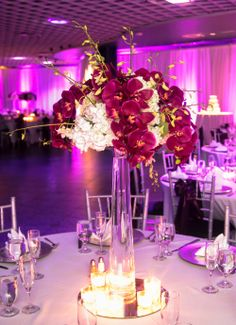 Tall White and Fuchsia Centerpiece of White Hydrangea and Dendrobium Orchids and Purple Phalenopsis Orchids  by Andrea Layne Floral Design (www.andrealaynefloraldesign.com)