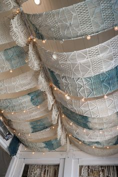 The Butcher's Daughter Patio decor, los angeles. Hanging ceiling macramé panels and fairy lights. Fabric Ceiling, Ceiling Decor, Ceiling Design, Ceiling Lights, Boutique Interior, Restaurant Concept, Restaurant Design, Hangout Room, Colored Ceiling