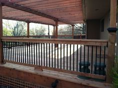 Beautiful redwood covered deck with modern railings. This is what my deck is starting to look like.