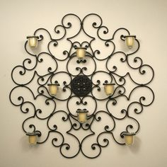 View our large selection of iron wall decor, oversized wall grilles, iron wall mirrors, wrought iron wall art and metal framed artwork in ou. Candle Wall Decor, Candle Wall Sconces, Wrought Iron Wall Decor, Metal Wall Decor, Iron Wall Art, Wrought Iron Candle Holders, Iron Furniture, Furniture Design, Tuscan Decorating