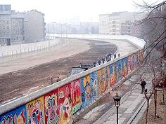 Photograph of the Berlin Wall taken from the West side. The Wall was built in 1961 to prevent East Germans from fleeing and to stop an economically disastrous drain of workers. It was a symbol of the Cold War and its fall in 1989 marked the approaching end of the war.