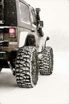 Jeep...aggressive tires...snow. Sounds right! Looks like this winter in the midwest!