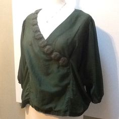 """Anthropologie Meadow Rue Top This gorgeous emerald color top was an online anthro purchase that didn't fit and hung in the closet """"to be returned"""".  As if....anyway, the details are beautiful and the fabric is a cotton and silk blend.  Dolman sleeves. Gorgeous stitching.  PLEASE NOTE:  as I was placing this top on the mannequin I caused a tiny pull as seen in photo 4 collar area hence the adjusted price drop. (It's the little dot on the collar a few inches from the edge.) Anthropologie Tops…"""