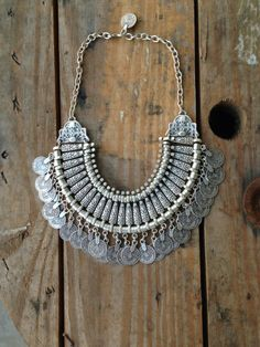 This necklace will fit you like a bib necklace, right on your collar bones. It has a Turkish coin and hook for the closure. This antiqued zinc necklace will not tarnish and is nickel and lead free.Made in Turkey
