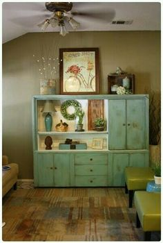 I chose this image because I love this distressed wall unit. I also really like the colour and how it is incorporated in the room with the floor and green leather chairs that you wouldnt think to be with it but it works !