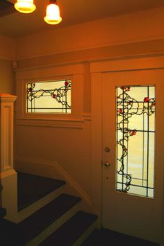 Pretty matching door and high window, with gnarled Vine pattern in black and red.